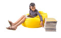 Girl reading books ii young malay asian a book on a yellow bean bag Stock Images