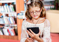 Girl reading an electronic book Royalty Free Stock Image