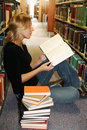 Girl reading in the library Royalty Free Stock Photography