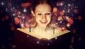 Girl reading magic book Royalty Free Stock Photo