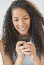 Girl reading text message on smart phone closeup of teenage Stock Photo