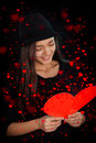 Girl reading valentine s day card beautiful a heart shaped valentine's Royalty Free Stock Images