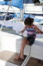 Girl reading on yacht Royalty Free Stock Photo