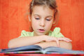 Girl reads book focuses Stock Photos