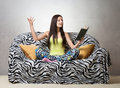 Girl reciting a poem inspired sitting on the sofa and Royalty Free Stock Image