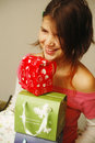 Girl reciveing gifts Stock Image