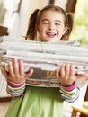 Girl recycling newspapers Stock Photo