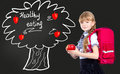 Girl with red apple. Royalty Free Stock Photo