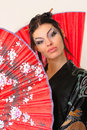 Girl with red asian fan Royalty Free Stock Photo