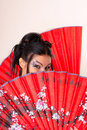 Girl with red asian fan Royalty Free Stock Images