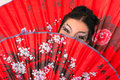 Girl with red asian fan Royalty Free Stock Photos