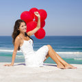 Girl with red ballons beautiful sitting in the beach Stock Photos
