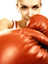 Girl in red boxing gloves Royalty Free Stock Image