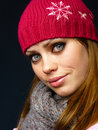 Girl in a red cap and a knitted scarf Stock Image