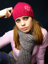 Girl in a red cap and a knitted scarf Stock Images