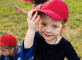 Girl with red cap is smiling to camera Royalty Free Stock Photo