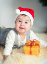 Girl with a red cap sweet gift in Stock Photo