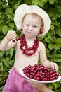 Girl with red cherry beads and earrings Royalty Free Stock Photo