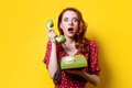 Girl in red dress with green dial phone Royalty Free Stock Photo