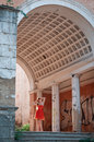 The girl in the red dress walking through ruins Royalty Free Stock Photos