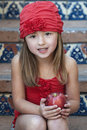 Girl in Red Hat, Holding an Apple Royalty Free Stock Photo