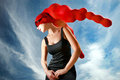 Girl in red head dress under blue sky Royalty Free Stock Image