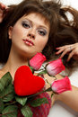 Girl with red heart and roses Stock Images