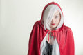 Girl in red hood young lady hooded cape Royalty Free Stock Photo