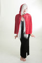 Girl in red hood young lady hooded cape Stock Photo