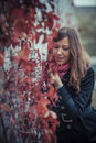 Girl with red leaves Royalty Free Stock Images