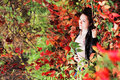 Girl in red leaves lying the autumn an autumn park Royalty Free Stock Photo