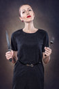 Girl with red lips a fork and knife Royalty Free Stock Photography