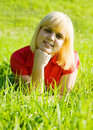 image photo : Girl in red lying on  grass