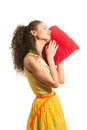 Girl with a red pillow young attractive in yellow t shirt hold Royalty Free Stock Photography