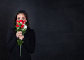Girl with red roses on hand Royalty Free Stock Photo