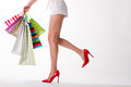 Girl in red shoes with shopping bags. Royalty Free Stock Photo
