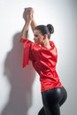 Girl in red silk tunic and black leggings posing Stock Photo