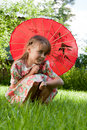Girl with red umbrella Royalty Free Stock Images