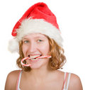 Girl with  red and white candy cane Royalty Free Stock Photos