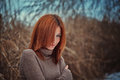 The girl in the reeds red haired a sweater Royalty Free Stock Image