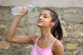 Girl refreshing herself teenager refreshes by throwing water on her face Stock Images