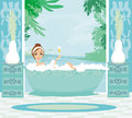Girl relaxes in the bath in a tropical spa Royalty Free Stock Images