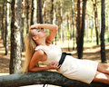 Girl relaxing in pine wood Royalty Free Stock Photo