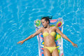 A girl is relaxing in a swimming pool top view of the on lilo Royalty Free Stock Photos