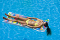 A girl is relaxing in a swimming pool top view of the on lilo Royalty Free Stock Photography