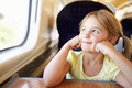 Girl relaxing on train journey smiling Royalty Free Stock Photo