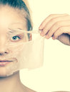 Girl removing facial peel off mask Royalty Free Stock Photo