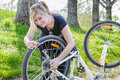 Girl repair her bicycle Royalty Free Stock Photo