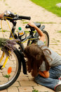 Girl repairing bike  Royalty Free Stock Photos