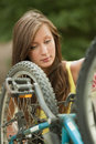Girl repairs a bike Royalty Free Stock Photo